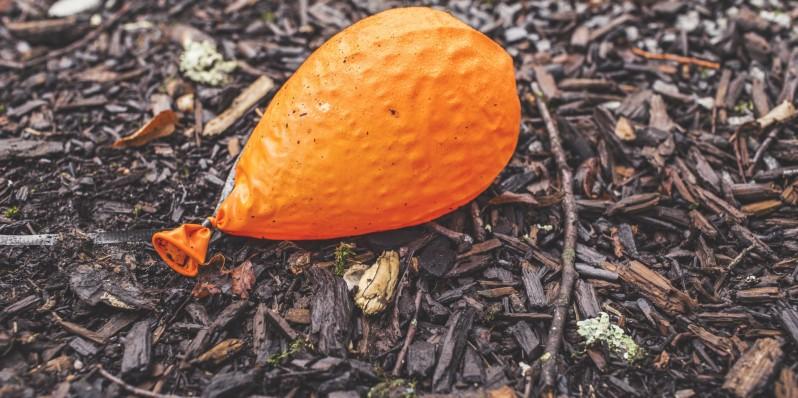 ground-orange-balloon-deflated